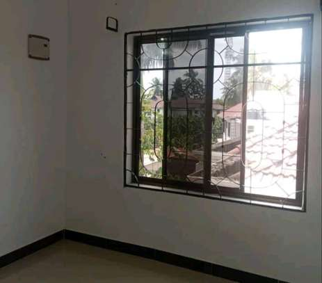 1master bedroom and seating room at mwenge image 5