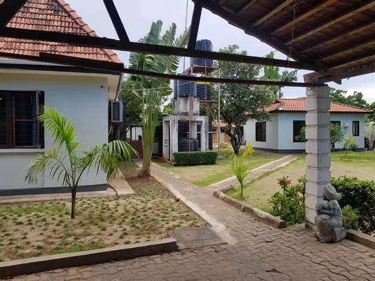 4 bed room stand alone house with big compound  for rent at mikocheni ridhiwani image 10