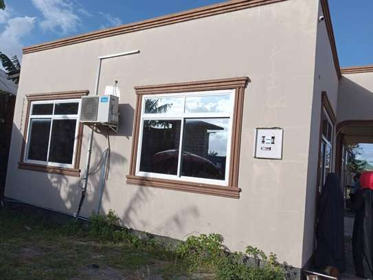 yard  with office for rent at yombo buza image 1