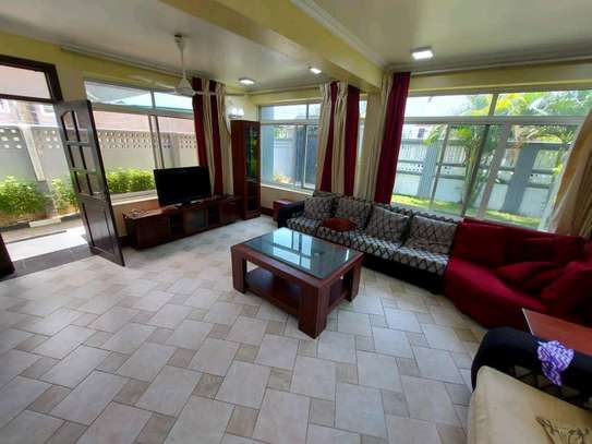 a 3bedrooms fully furnished standalone in mikocheni with a paved street image 3