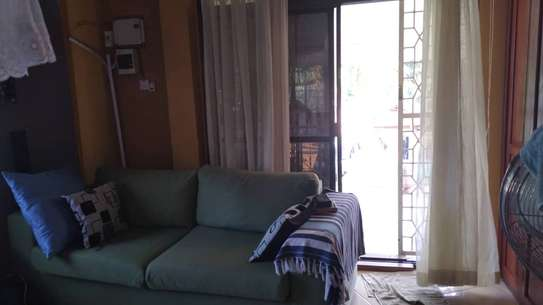 Cute and Classic 1 BR upstairs apartment for rent at Msasani image 5