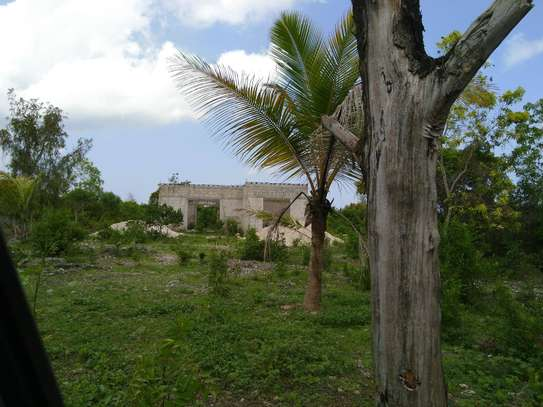 beautiful land with unfinished house 60 meter from the beach