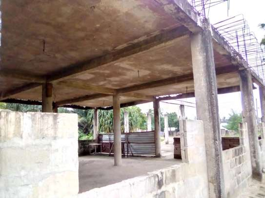 Tarmac road-front semi-finished commercial house/1300sqm. going cheap at PUGU image 2