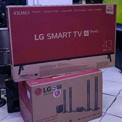LG SMART TV 43 AND HOME THEATER 1000W image 1