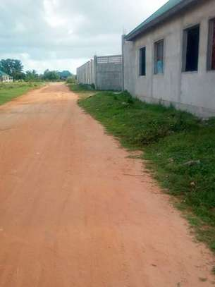Big yard 12 acre at kisemvule with 4bed house in the yard for sale tsh 700million image 1