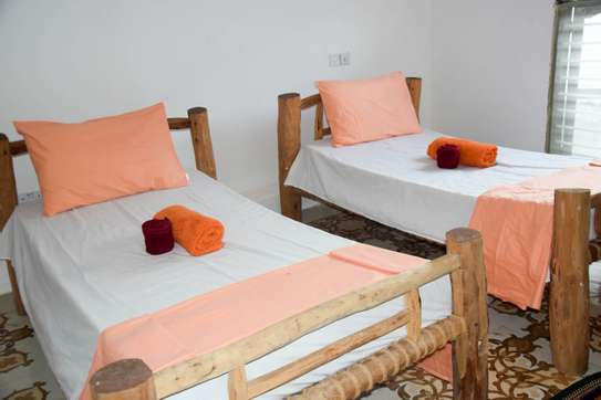 Wooden beds with mattresses