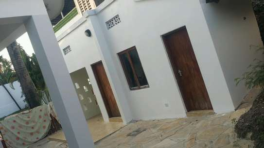 a luxurious standalone mansion is for rent at masaki walkind distance to the beach image 11