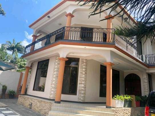 a 4bedrooms bungalow is for sale at mbezi beach very cool street image 1