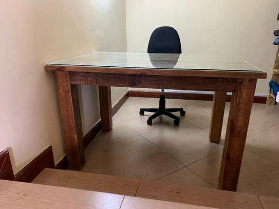 Beautiful wooden table with glass cover