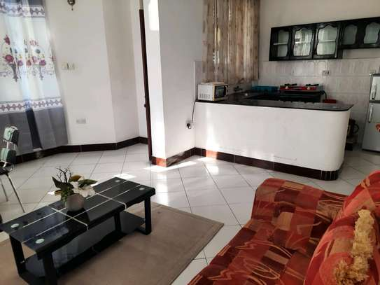 a 1bedroom fully furnished at mikocheni very close to shoppers plaza on a paved road image 4