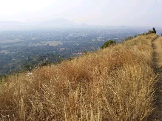 Land for sale at Morogoro on top of Mountain 360° view of water falls/town/Mindu dam/mountains image 1