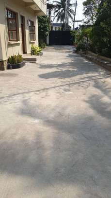 2bed in the compound ground floor big parking of 8 car at mikocheni a image 8