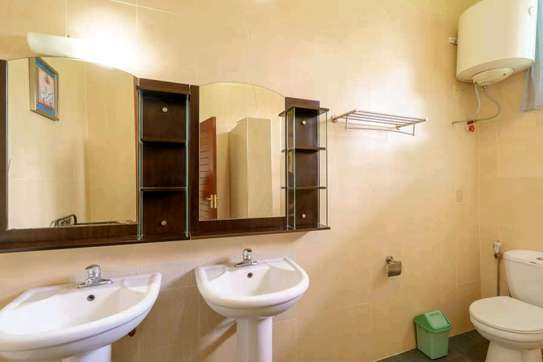 a 2bedrooms  VILLAS fully furnished in MBEZI BEACH is available for rent now image 5