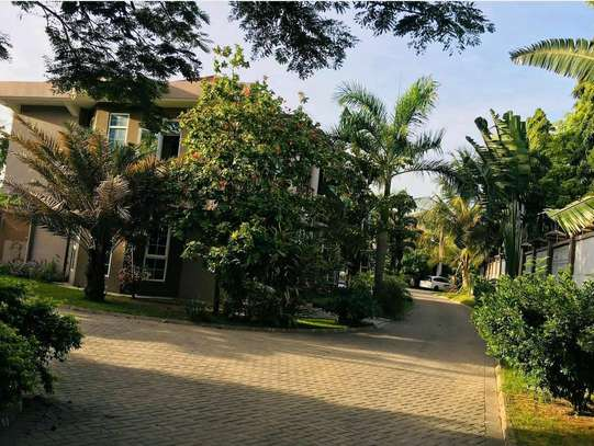 VILLA is for rent at MBEZI BEACH  with a pool and very close to main road  cool street image 3