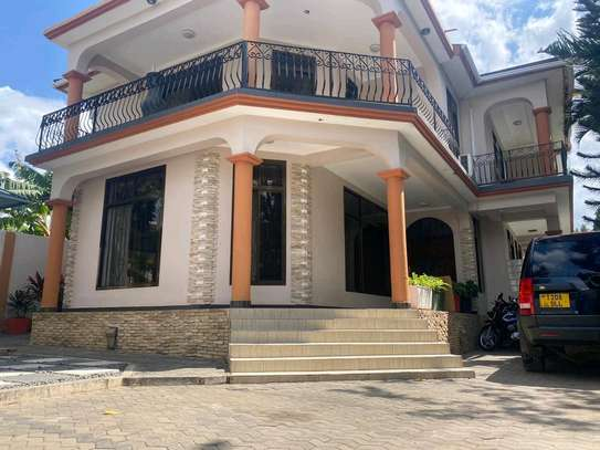 a 4bedrooms bungalow is for sale at mbezi beach very cool street image 2