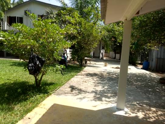 small 1bed shared house at masaki near sea cliff court tsh 600,000 image 3