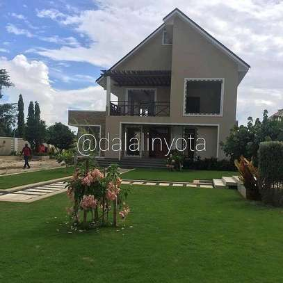 4 BDRM HOUSE AT BAHARI BEACH image 1