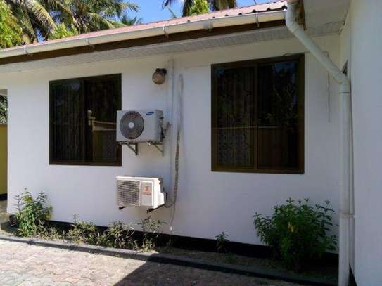 2bed furnished house at mikocheni 850000 image 1