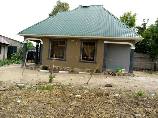 3bed house at mivumoni tsh150 area 400sqm image 1