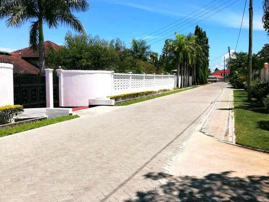 villas in mbezi beach are now available for rent very cool street image 1