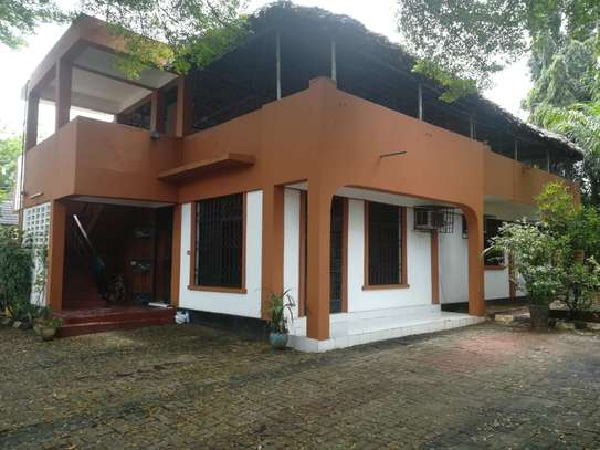 3 bed room {2master} stand arone house for rent at msasani near BBQ with a tarrance and makuti roof  $1000pm image 1