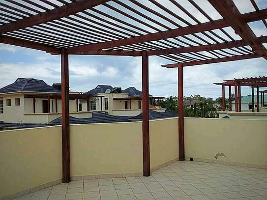 a 4bedrooms fully furnished villas are for rent at mikochen very close to main road image 13