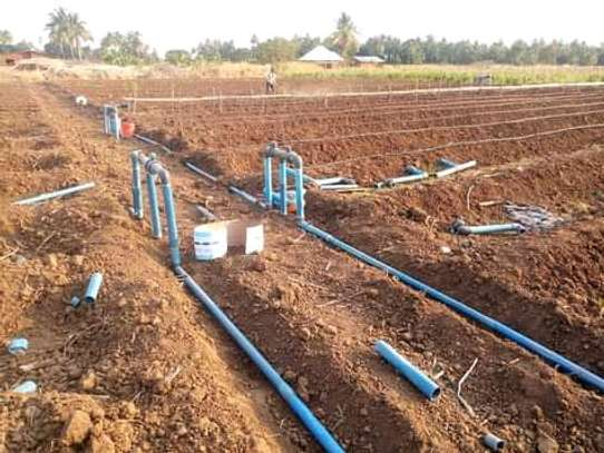 Irrigation system installation in farm image 6