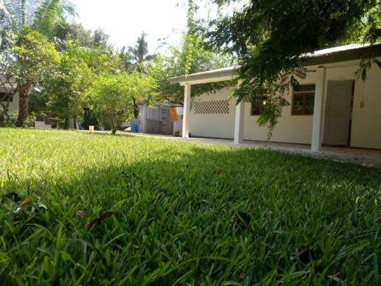 small 1bed shared house at masaki near sea cliff court tsh 600,000 image 1