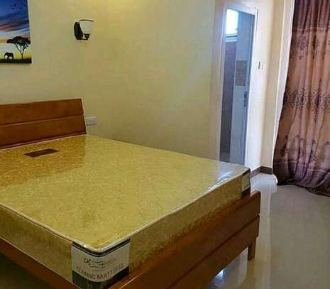 a 2 bedrooms fully furnished appartment is available for rent at msasani very cool neighbour hood image 3
