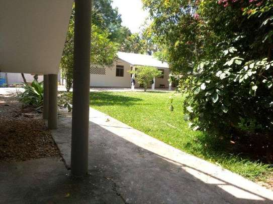 small 1bed shared house at masaki near sea cliff court tsh 600,000 image 7