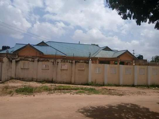 Two house for sale at kinyerezi ilala dar-es salam each have independent luku contains 3bedrooms dining,siting rooms ,kitchen with 3business frems and this is the corner plot  at price of tzsh 170m afordable and negotiable image 4